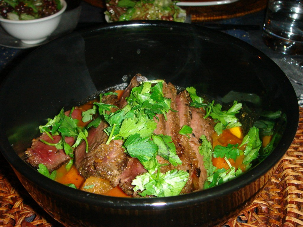 Sate-marinated ostrich and vegetable tagine