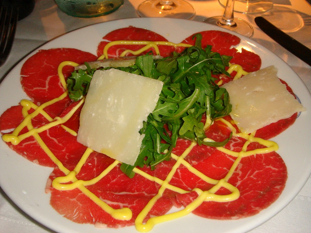 Beef carpaccio with rucola, parmesan & chef's special sauce