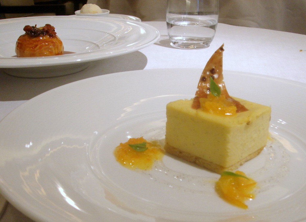 Ricotta cheesecake & baked apple in the background