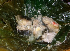 Catfish cooked in marantaceae leaves