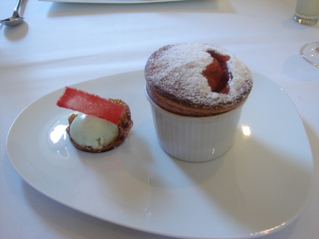 Raspberry soufflé with lemon verbena ice cream & red fruit coulis