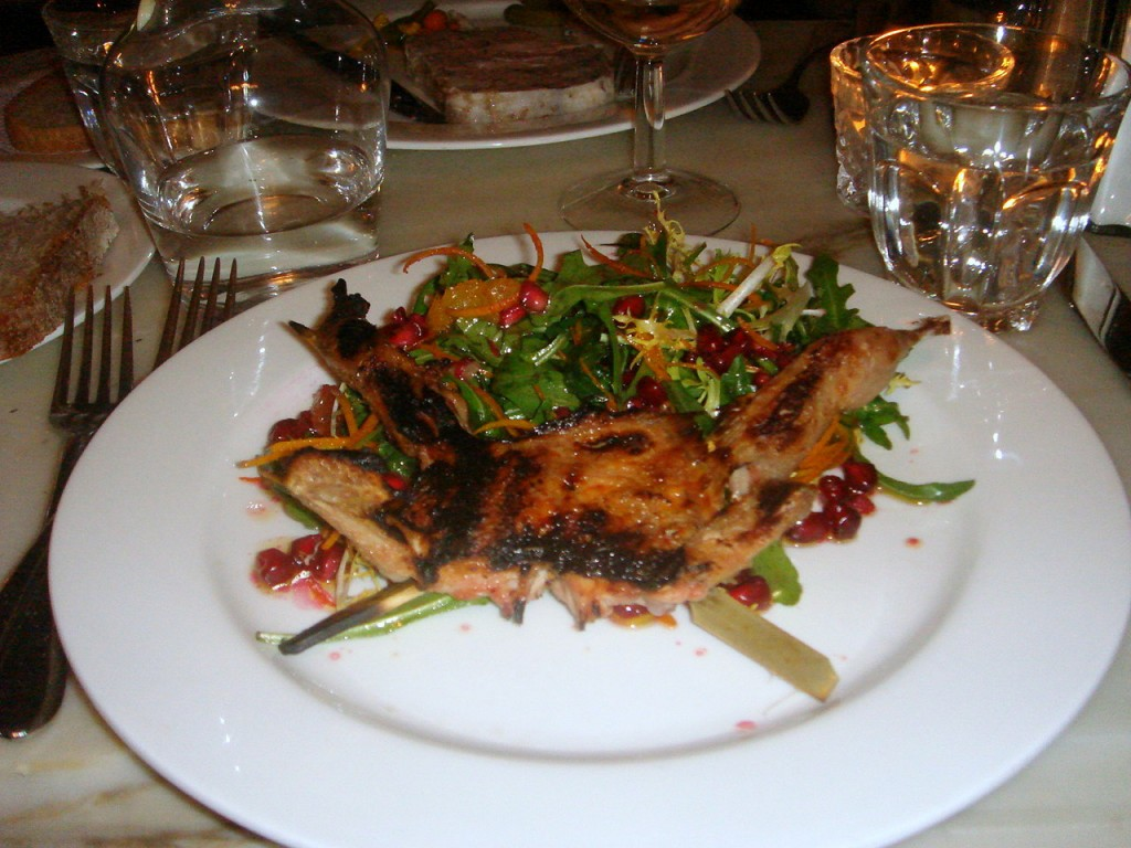Grilled quail, orange & pomegranate salad