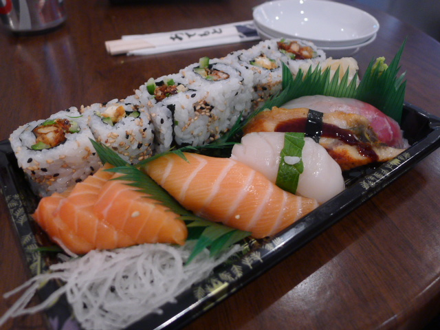 Salmon sashimi, various sushi and soft shell crab roll