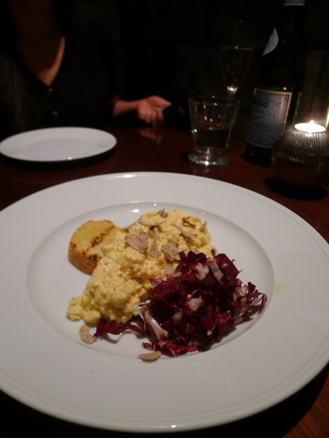 Diciannove - uovo in padella con insalatina di radicchio,  pan-fried egg served with small chicory salad, corn bread crostino with truffle butter, parmesan and white truffle shavings