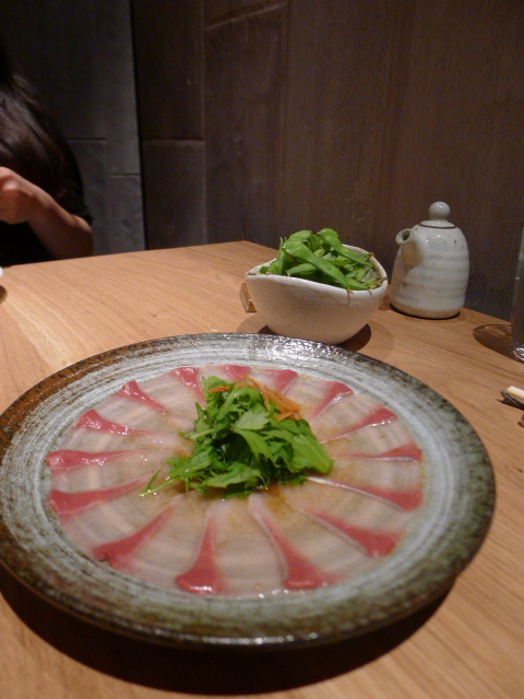Roka - yellowtail sashimi with truffle yuzu dressing, mizuna and pickled vegetables