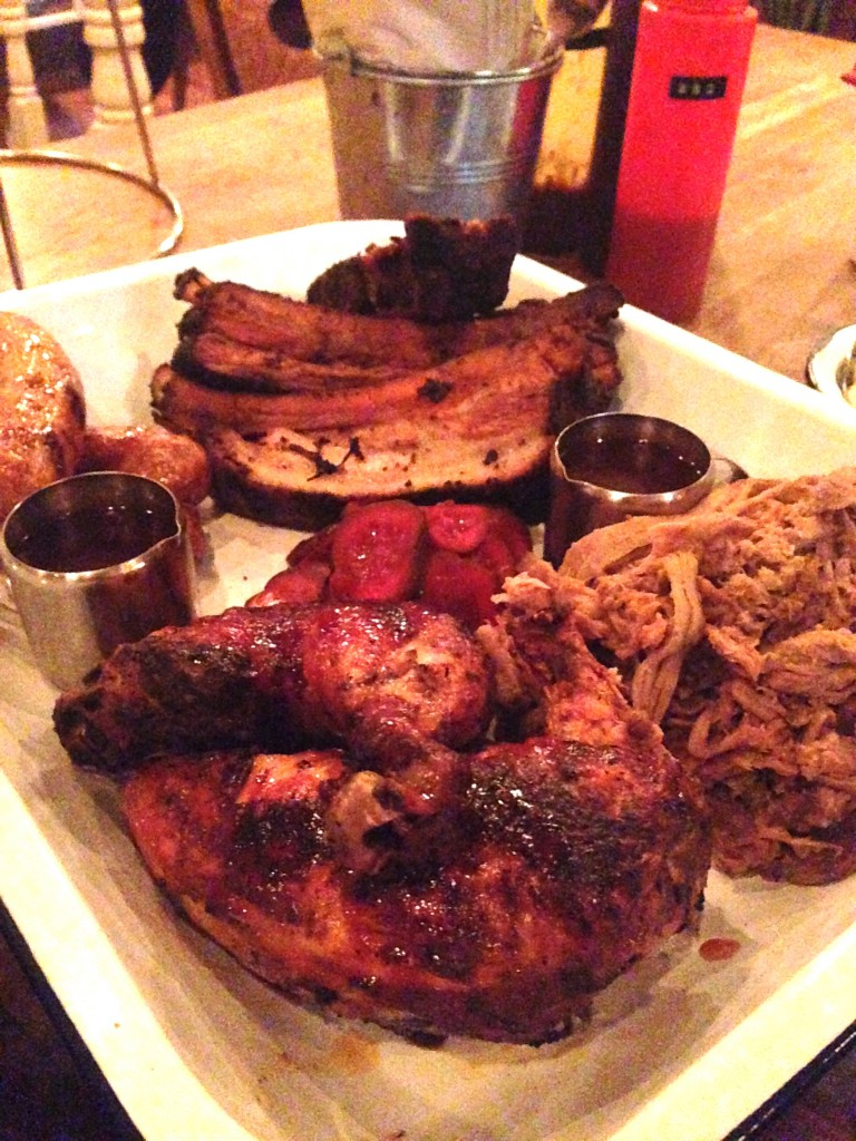Porky's - The Ultimate includes a full portion of Memphis meaty ribs and tips, pulled pork, and half bbq chicken served with four hot links