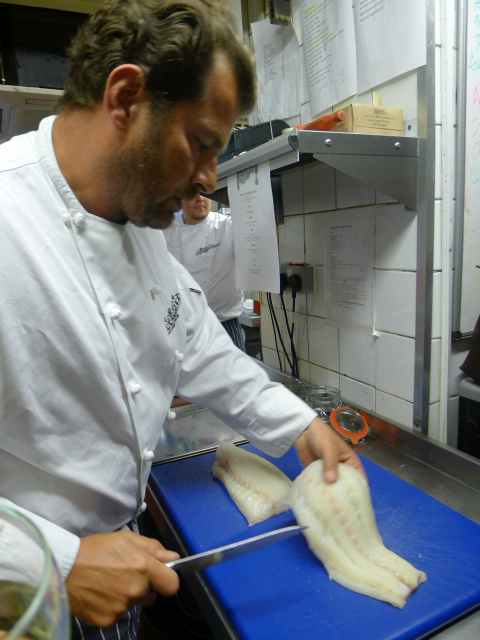 Randall & Aubin – London Food Blog – Chef prepping the cod for lunch